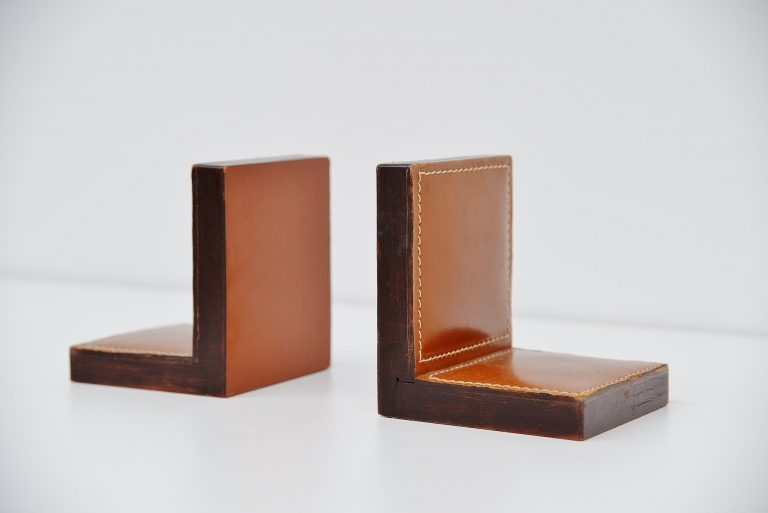 Jacques Adnet leather book stands France 1960