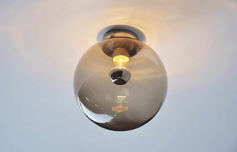 Pair of Globe sconces by Raak Amsterdam 1971