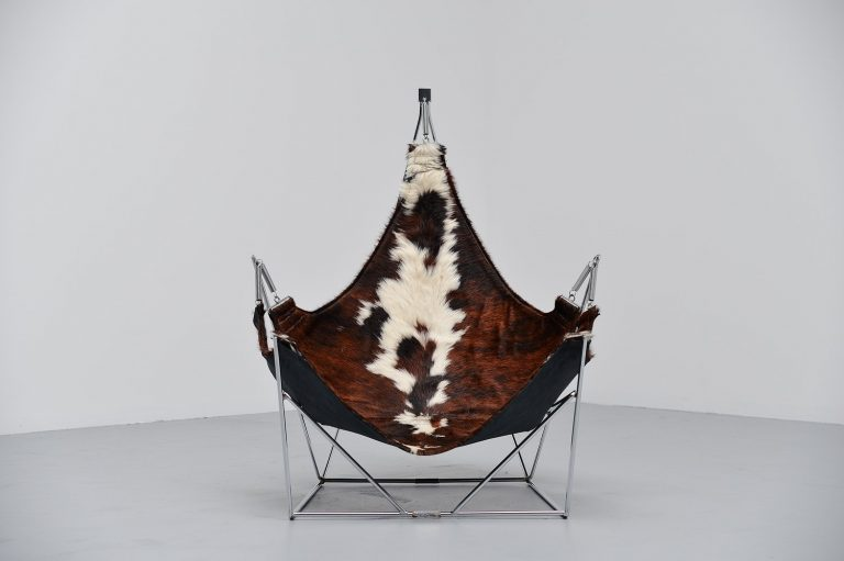 Beautiful sculptural lounge chair with cowskin seat France 1960