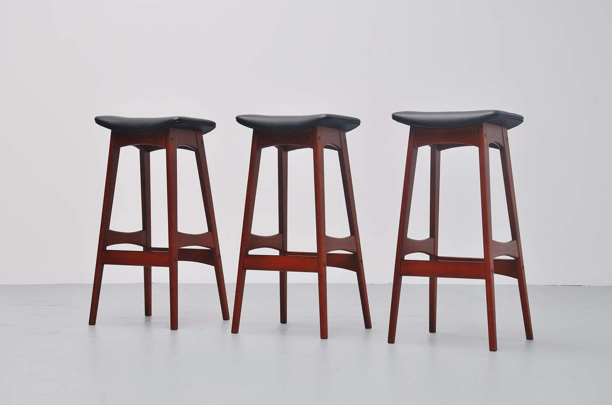 Picture of: Johannes Andersen Teak Bar Stools Black Leather Denmark 1961 Massmoderndesign