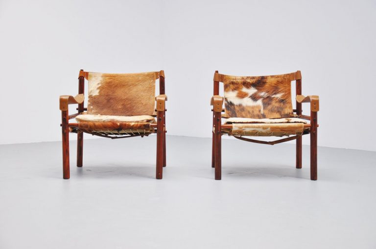 Arne Norell safari chairs with cow skin seats 1960
